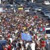 4746278_6_c34e_des-centaines-de-migrants-marchent-sur_41b12f540a9bbb9e5eb751aa7b7c7d64