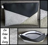 Pochette Triangle 17 € Simili noir - Por - P argent