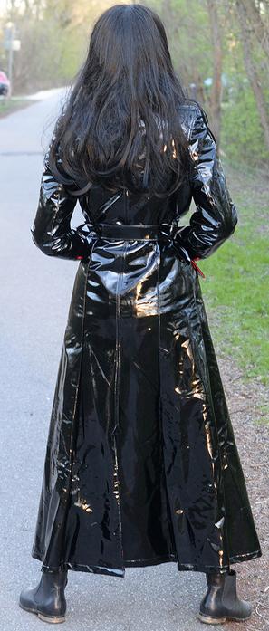 Charming Lady in shiny raincoat