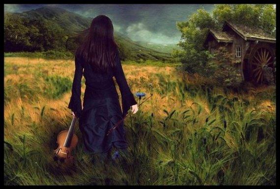 jeune violonniste dans champ