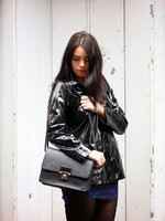 Fashion blogger Emma Louise Layla in black patent waxed Petit Bateau raincoat