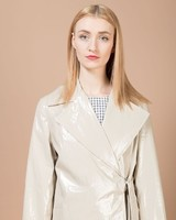 alessia-xoccato-beige-vinyl-trench-front-detail_04_1500x