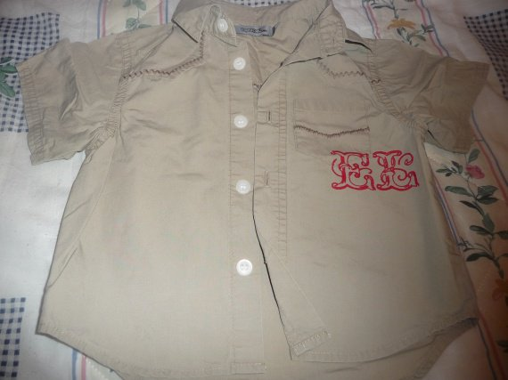chemisette  2 ans tape à l'oeil 2.50 euros