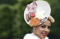 a-race-goer-poses-wearing-a-hat-featuring-a-full-english-breakfast-at-royal-ascot-on-ladies-day-sout