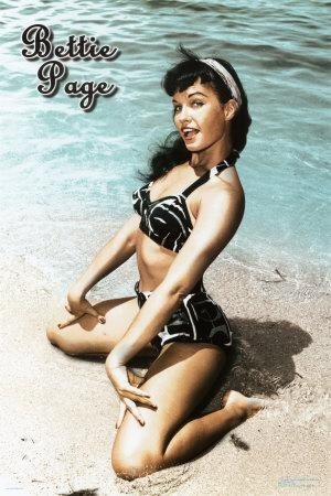 betty-page-sitting-winking-on-the-beach1