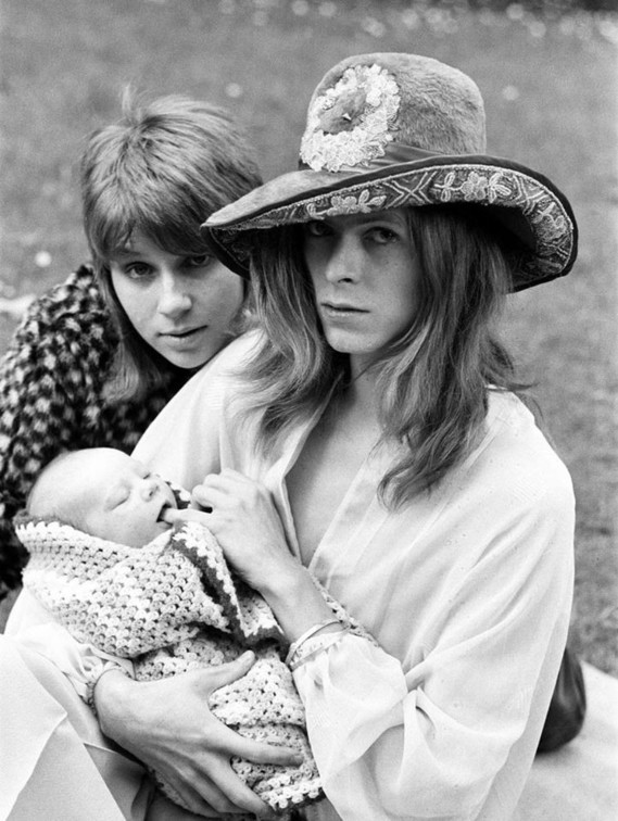 David Bowie and Angie, with Duncan Zowie Haywood Jones sucking dad's finger- June 29, 1971, by Ron B