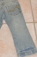 dos jean okaidi (usure d'origine aux poches)