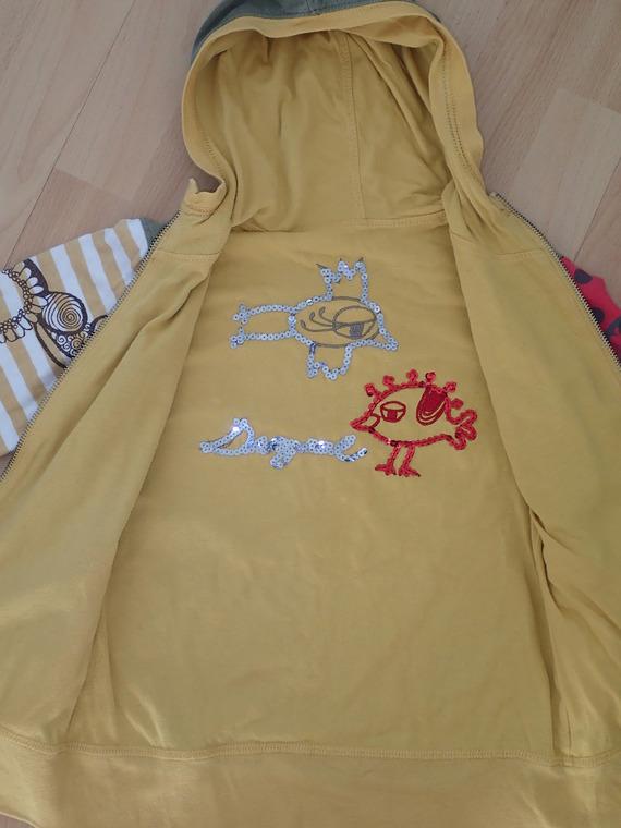 intérieur réversible jaune avec sequins dans le dos