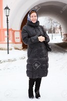 12022272-Russian-woman-in-winter-clothes-against-Orthodox-monastery-building-Pilgrimage-Stock-Photo