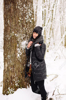 36584877-Girl-in-winter-forest-Stock-Photo