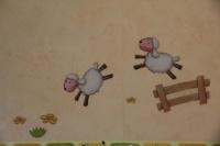 Moutons au dessus du lit