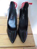 Pleaser noir avec nœud rouge derriere pP10 T12cm
