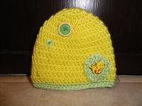 Chapeau jaune dinosaure