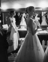 Audrey Hepburn and Grace Kelly wait backstage during the 1956 Academy Awards