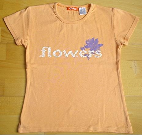 tee-shirt orangé OKA.OU 10 ans : 4 euros.