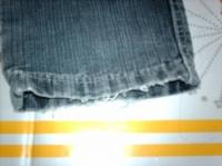 détail du jean, bas éffiloché