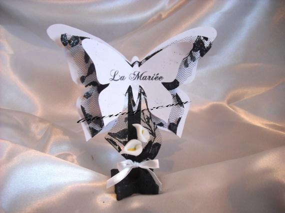 marque place papillon noir et blanc