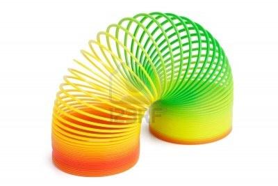 11160839-belle-jouet-colore-ressort-en-plastique-sur-un-fond-blanc